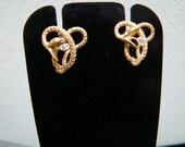 Equisitely detailed 14K Gold snake stud earrings wtih diamonds