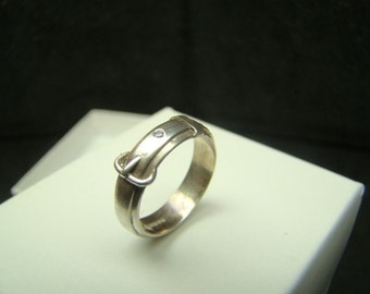 Sterling silver buckle ring with diamonds