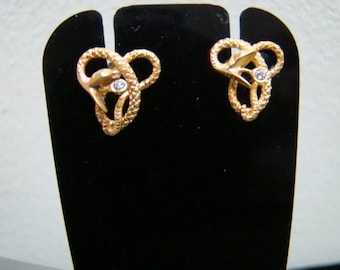 Equisitely detailed 14K Gold snake stud earrings wtih diamonds