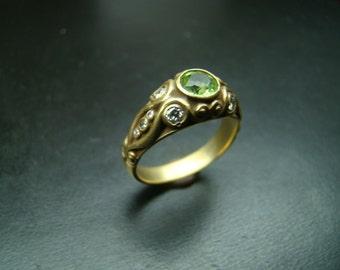 Regal 14k Gold diamond and peridot scrolled ring.