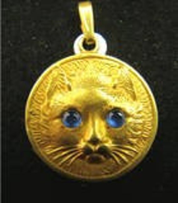 14K gold cat pendant with cabachon sapphire eyes