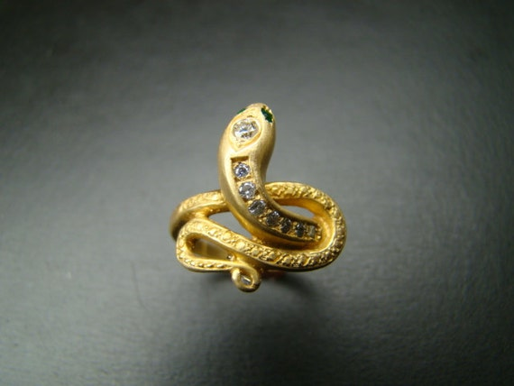 Classically beautiful 14K gold snake ring with diamonds and emeralds