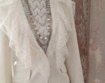 Up cycled jacket with vintage lace and more.