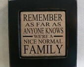 REMEMBER - As Far As Anyone Knows We're A Nice Normal Family vinyl saying in frame -