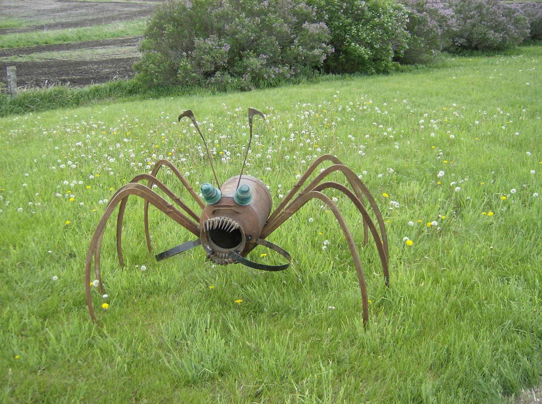 Spider yard art upcycled farm art by iowametalart on etsy for Daylight designs metal garden art