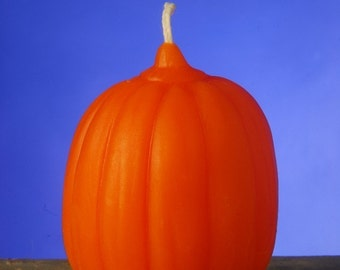 Orange pumpkin beeswax candle by queen bee honey products