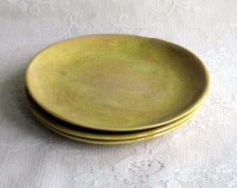 Handmade side plates mustard yellow, set of four, Side plates by Leslie