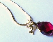 Ruby red swarovski crystal flat briolette pendant with dolphin charm.