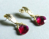 Ruby swarovski crystal on a matte gold leaf stud earrings.