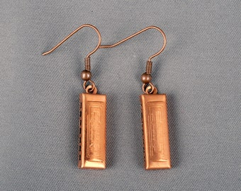 A darling pair of antique copper harmonica charm earrings