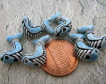 4 Tiny Tribal Whale Beads