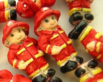 4 Tiny Ceramic Firemen Beads - CB654