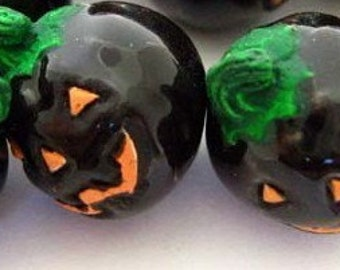 4 Tiny Black Jack-O-Lantern Beads