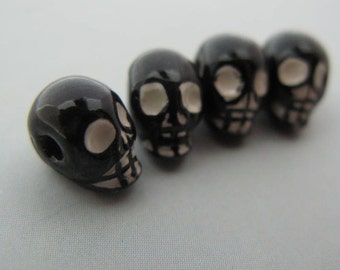 4 Black Skull Beads - horizontal - CB674