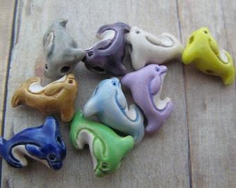 20 Tiny Ceramic Dolphin beads (mixed) - CB647