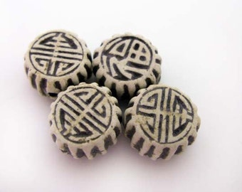 4 High fired Chinese Beads