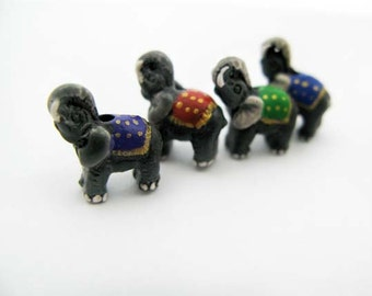 4 Tiny Elephant Beads - mixed mantas
