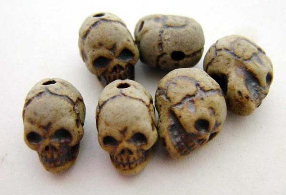 20 Tiny High Fired Skull Beads - vertical holes - CB644