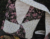 Swirls and triangles quilted bag