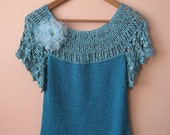 Fancy crochet top with short sleeves in turquoise blue