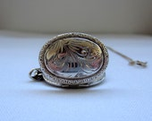 Vintage Oval Locket. Sterling Silver. 1970s.