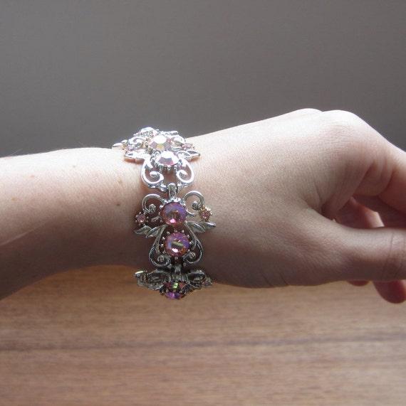 Vintage Coro Bracelet. Pink Rhinestones and Silver Tone. Circa 1950s.