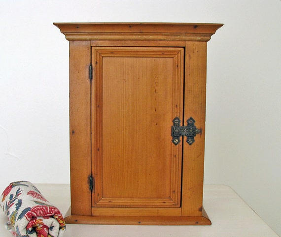 Wood cabinet with metal latch