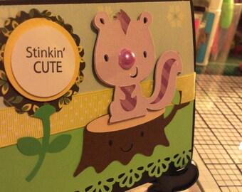 Stinkin cute skunk flower greeting card