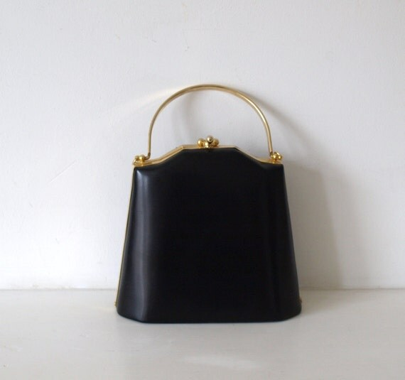 Vintage 1980s does 60s matte black vinyl box bag with gold tone metal handle and long strap