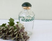 Decorative Clear Bottle with Green Leaves