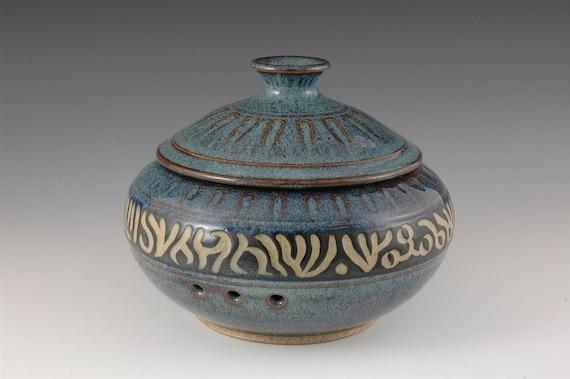Blue with black carved design stoneware lidded garlic keeper