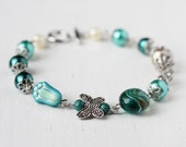 Spring Bridesmaid Jewelry Teal Bracelet with Green Czech Glass Beads, Butterfly Connector, Lampwork Glass and Glass Pearls