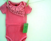 Pink Ruffle onesie. Nb up to 24 months.