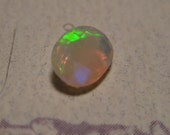 faceted Ethopian Opal  ....   7 x  5  x  3mm .........    2371