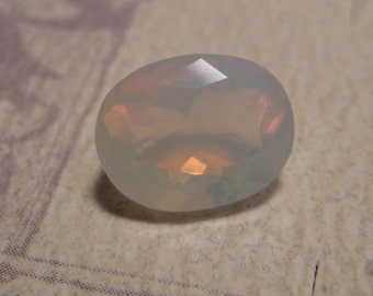 African White Opal ... Faceted Stone ..........   11 x 9 x 7mm ................   (AWOfs11/9-7)