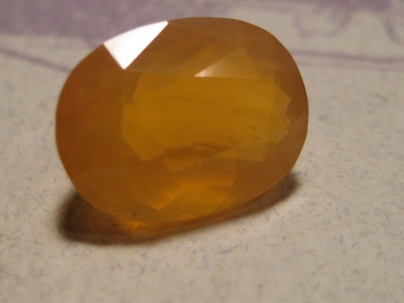 Mexican Opal faceted gemstone ...... BEAUTIFUL ......   13  x 9  x   7 mm   ........                  4231