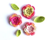 Crochet pink flowers applique, embellishments, scrapbooking with green leaves decorations