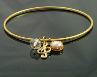 16 karat gold plated bangle with goldfilled ornaments