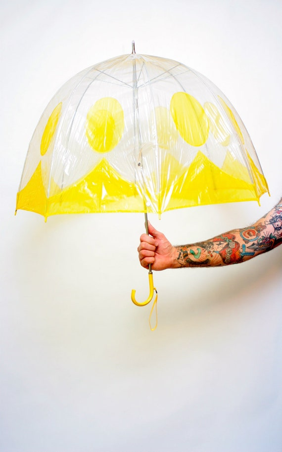 Clear umbrella with yellow trim and polka dots