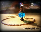 Blue and silver Swarovski and glass elixir bottle charm necklace