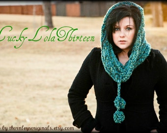 Knitted green and blue ribbed cowl scarf with pom pom tassles