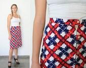 Reserved. Vintage 1960s mod skirt / midi skirt criss-cross print  (Small)