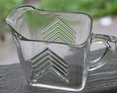 Two Clear Glass Small Pitchers