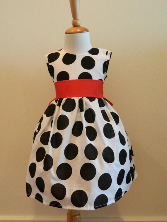 Girls Custom Hand Made Black And White Polka Dot Jumper Dress With Red Sash.