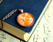 Abstract tree necklace made with vintage sheet music illustration.  Antiqued copper pendant with domed glass.