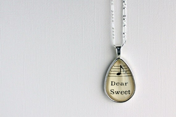 Unique gift for women sheet music tear drop pendant necklace silver plate and glass black and white music notes words dear sweet