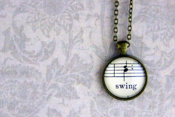 Sheet music necklace.  Antiqued bronze pendant with real vintage sheet music under glass dome.  Swing