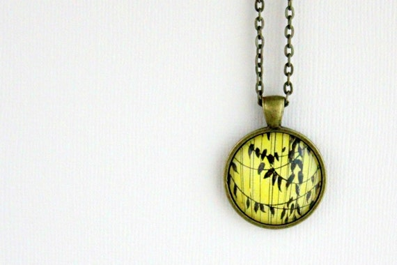 On Sale - WAS 28.00 Fall leaves necklace made with vintage sheet music illustration.  Antiqued bronze pendant with domed glass.