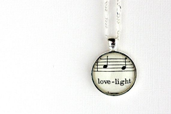 Love light necklace.  Silver pendant with real vintage sheet music under glass dome.