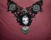 Memento mori Infant face choker with silver heart